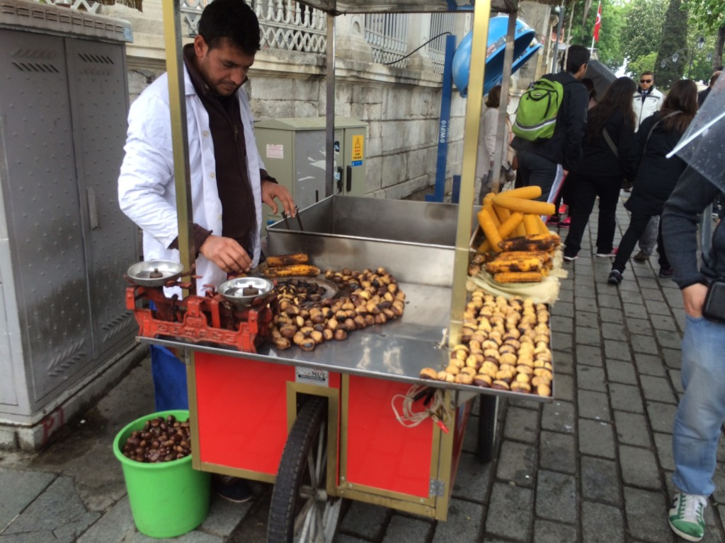 Roasting chestnuts and corn out on the street near the Sophia Mosque