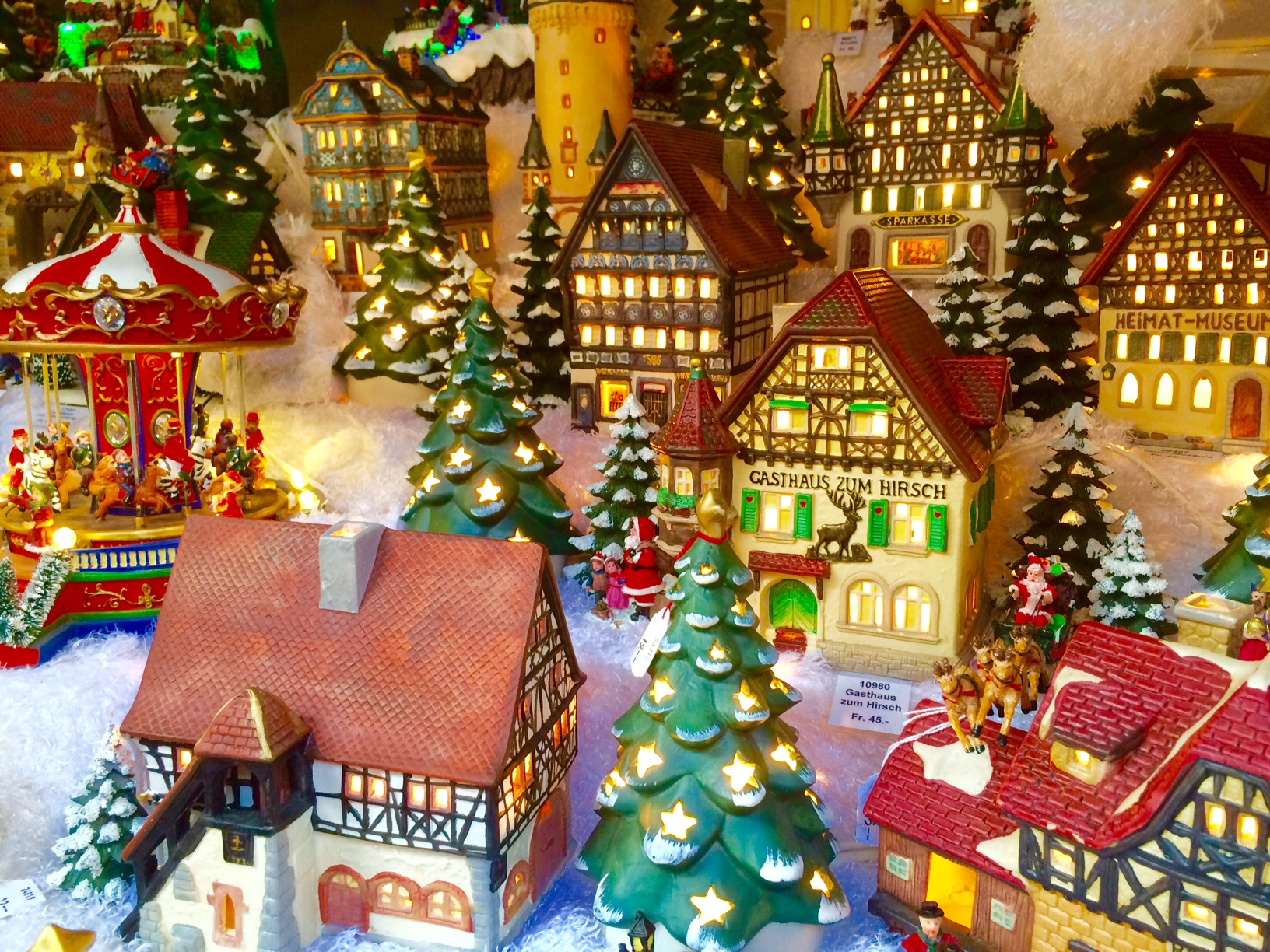 a lighted miniature christmas village in basel switzerland - Miniature Christmas Town Decorations