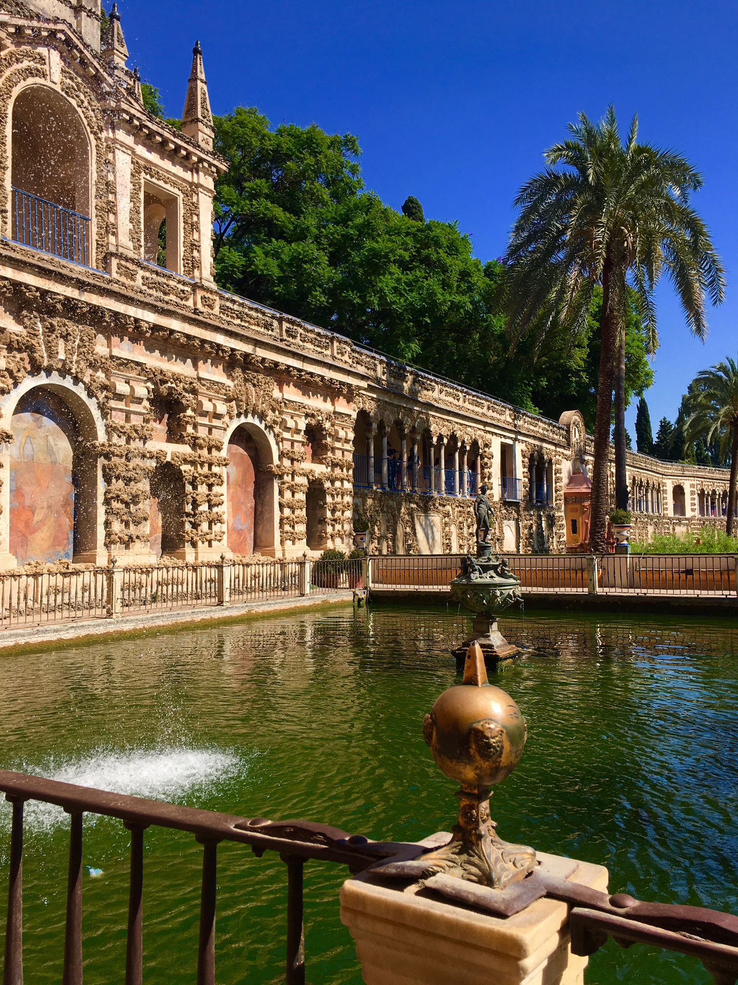 A pool in the private gardens of the Alcazar in Seville. On the ...